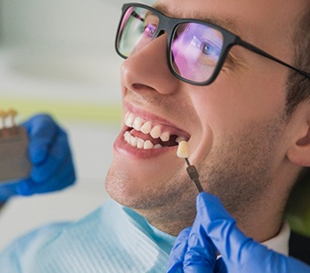 A young man having a tooth replaced