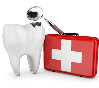 Emergency kit, dental mirror, and a decayed tooth