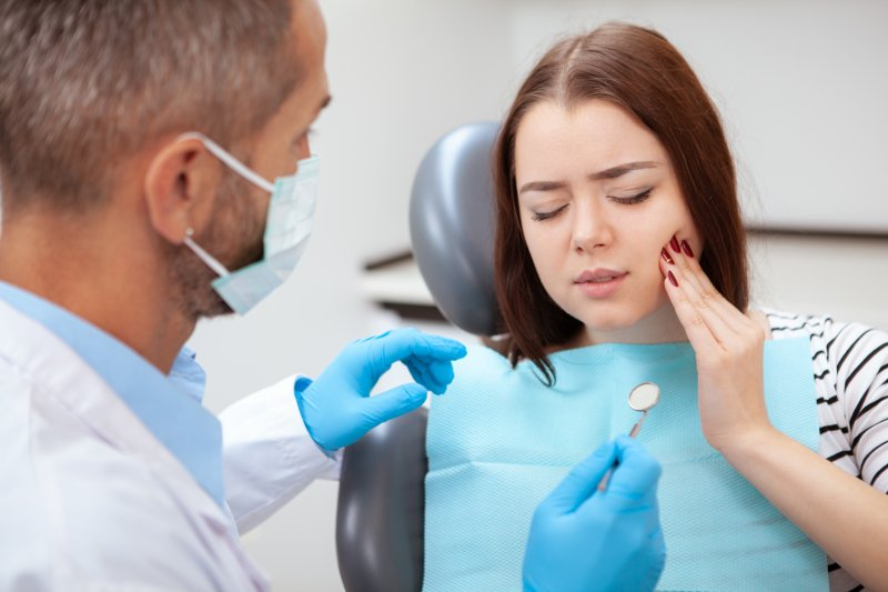Dentist treating a dental emergency