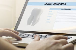 Person using computer to shop for dental insurance online